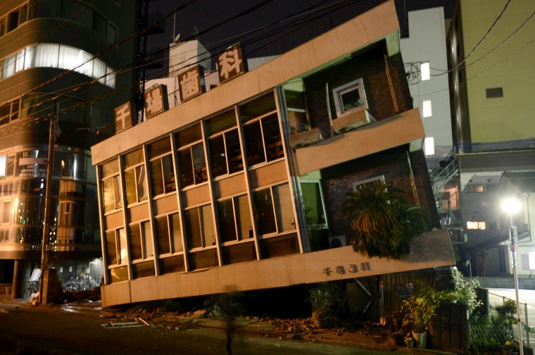 Image: A severely damaged dentist office leans to one side following an earthquake