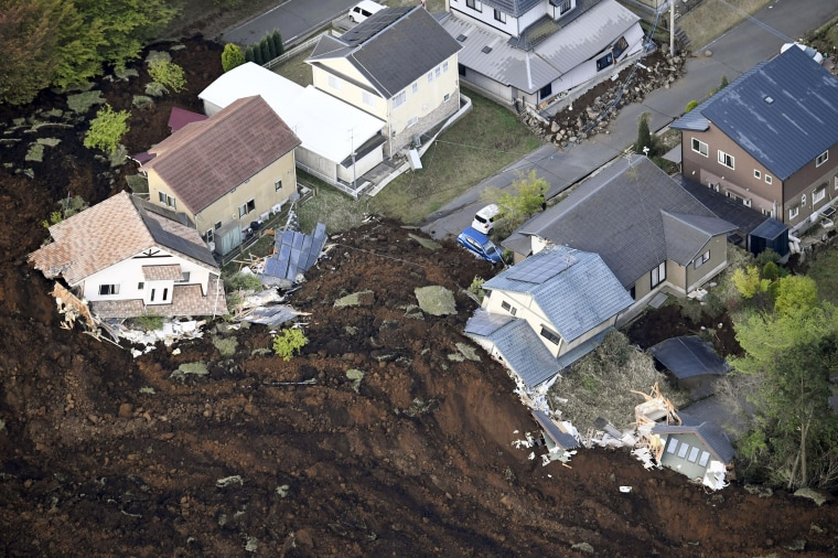 Image: Houses are buried in landslide caused by an earthquake