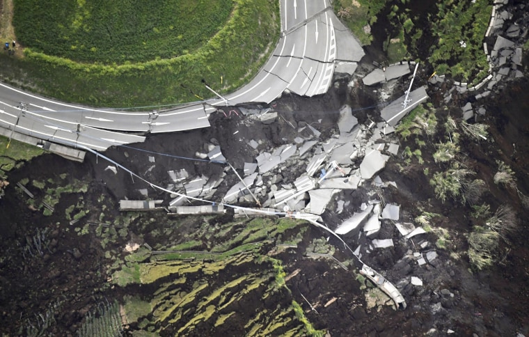 Image: A landslide caused by the earthquake destroys a road in Minamiaso