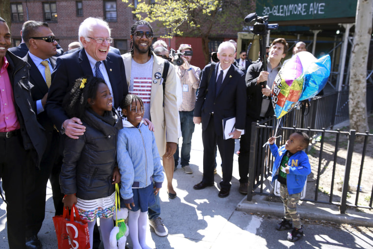 Image: Sanders greets residents during a walk through of the Howard Houses in the Brownsville neighborhood of the Brooklyn borough of New York