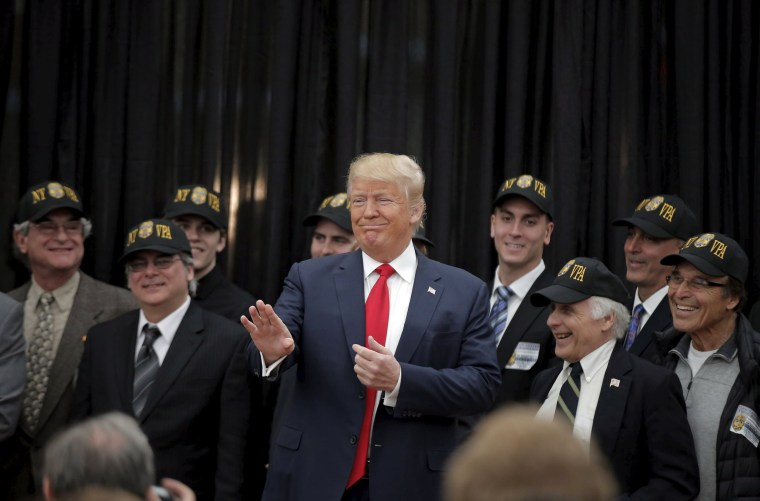 Image: U.S. Republican presidential candidate Donald Trump poses after receiving an endorsement from the New York Veteran Police Association in the borough of Staten Island in New York