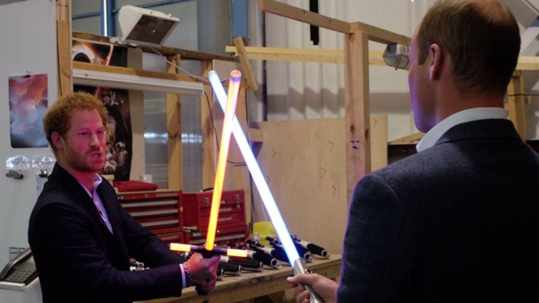Image: prince william and prince harry visit star wars, play with light sabers