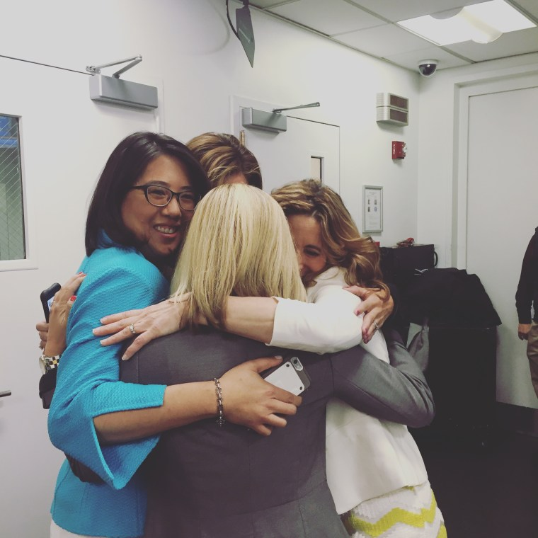 Tuesday's inventors hug it out after their segment.