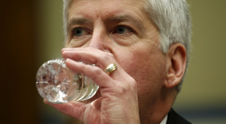 Image: Michigan Governor Rick Snyder drinks some water as he testifies for Flint Michigan water hearing on Capitol in Washington