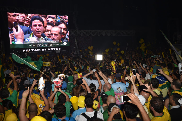 Image: Supporters of the impeachment of President Dilma Rousseff follow proceedings as lawmakers vote