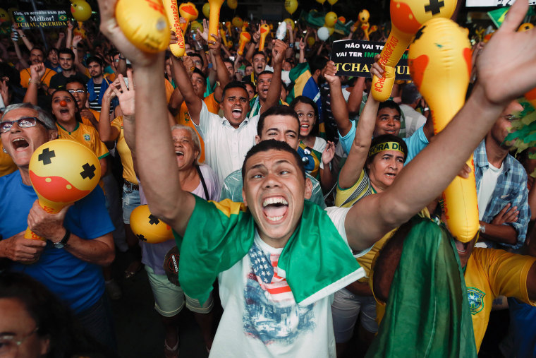 Image: Anti-government demonstrators celebrate the results of the vote in Sao Paulo