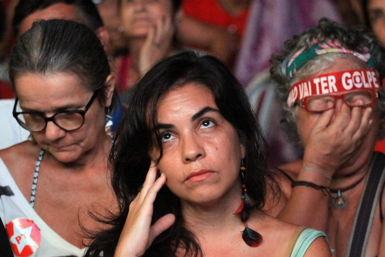 Image: President Rousseff's supporters sulk as they watch a screen showing the voting proceedings
