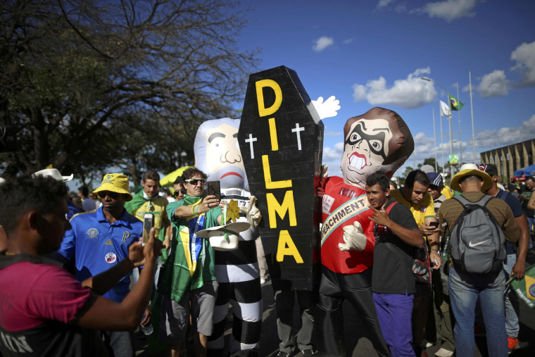 Image: Brazilians with a mock coffin demonstrate in support of the president's impeachment in Brasilia