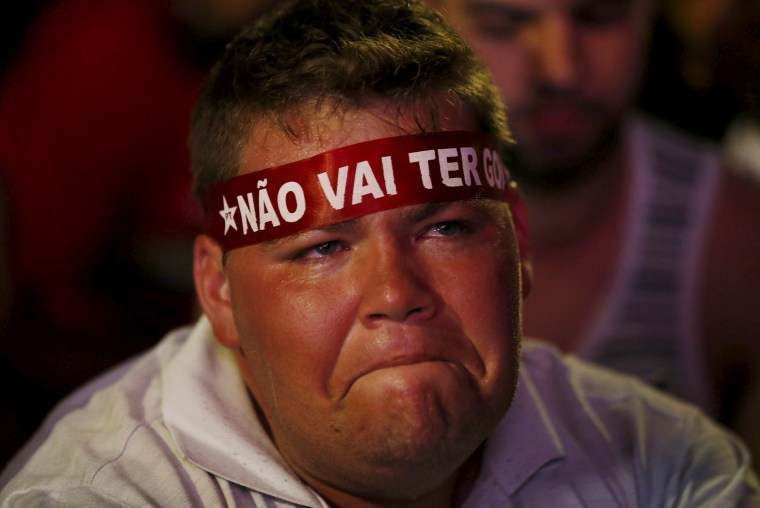 Image:A supporter of President Rousseff broods while watching the televised voting proceeding in Brasilia