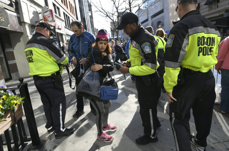 Image: Boston police check bags of spectators near the finish line before the start of the 120th running of the Boston Marathon