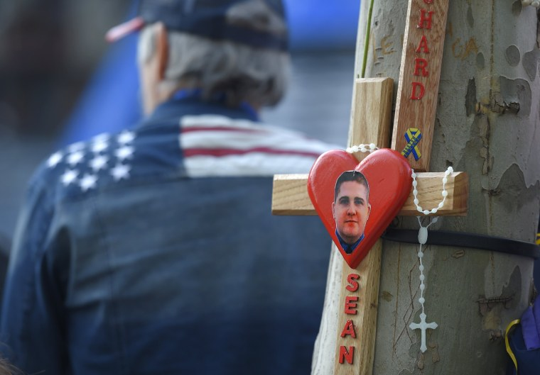 Image: An image of MIT police Officer Sean Collier who was killed days after the Boston Marathon attacks adorns a tree near the finish line before the start of the 120th running of the Boston Marathon