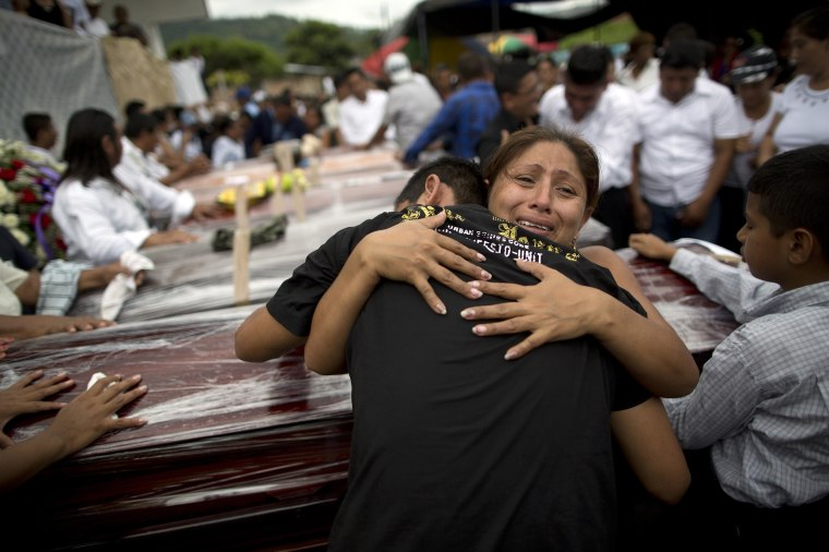 Image: Relatives mourn the loss of their family members, victims of the 7.8-magnitude earthquake