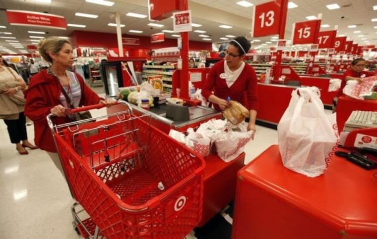 A Target employee checks out a customer at a store in Falls Church