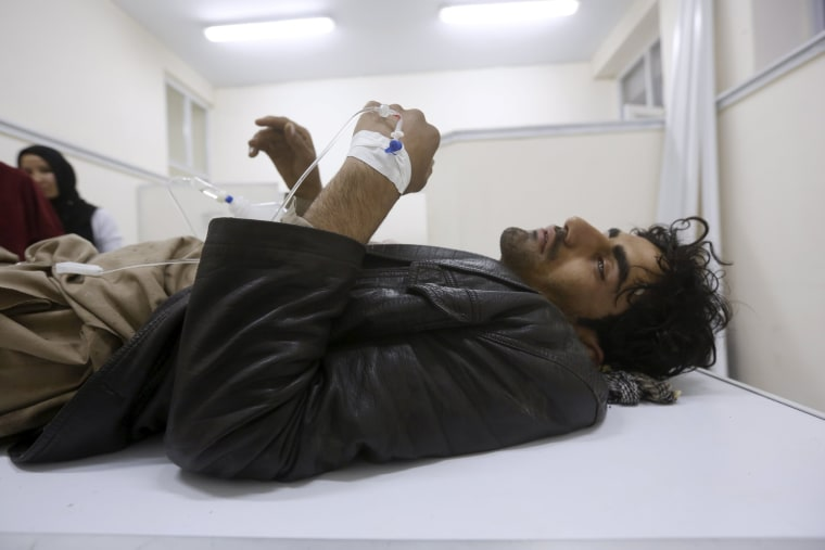 Image: An Afghan man receives treatment at a hospital after a suicide car bomb attack in Kabul