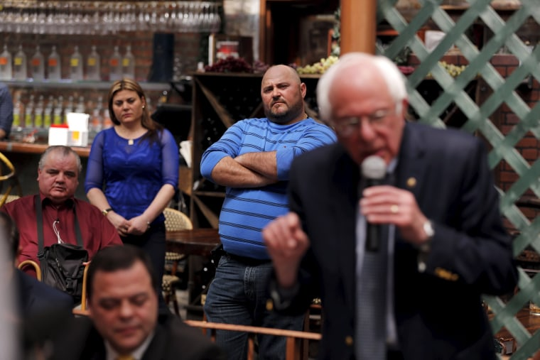 Image: Spectators listen as Democratic U.S. presidential candidate Bernie Sanders takes part in a round table to discuss immigration, public housing, and the current economical state of Puerto Rico in the Bronx borough of New York