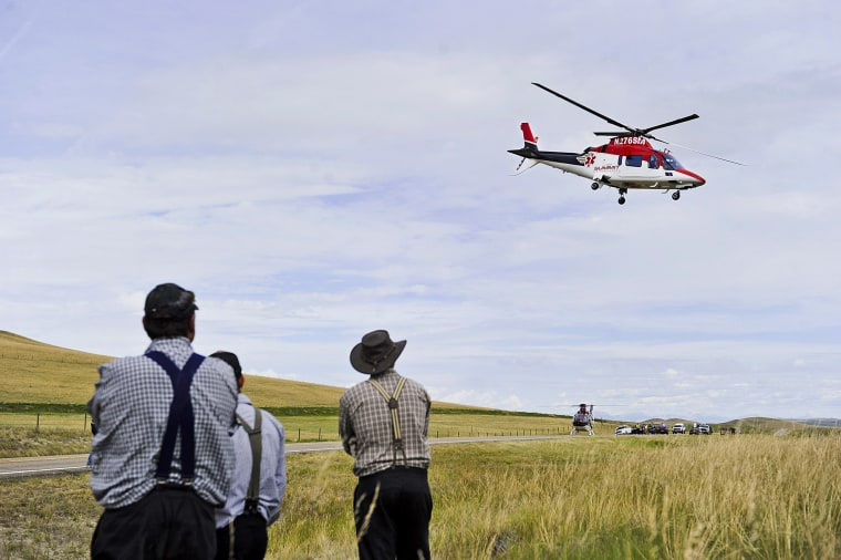 Ab emergency helicopter flies over the scene of a fatal collision on Highway 287, north of Wolf Creek, Montana, on July 15, 2015. Air ambulances are life-savers for many people who live in rural states such as Montana, but as the industry has grown, so too have complaints about soaring bills and the lack of regulations over the sudden influx of private companies that provide helicopter and fixed-wing emergency services.