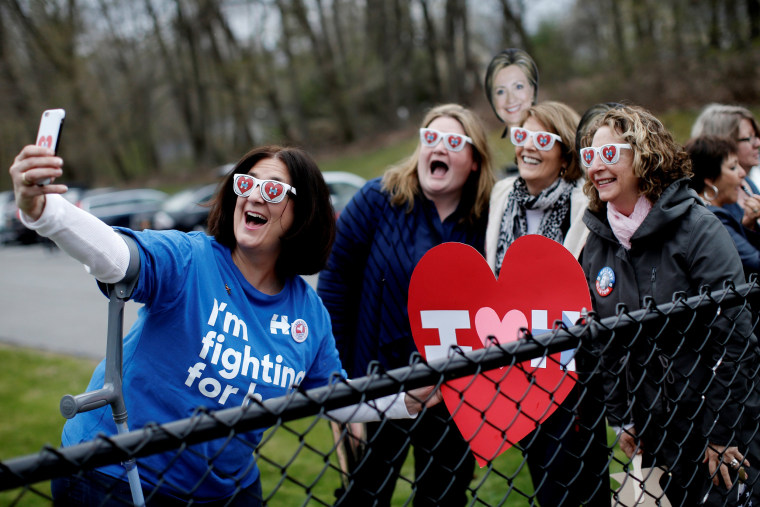 Image: Supporters of Democratic U.S. presidential candidate Hillary Clinton pose for a selfie photograph outside the Grafflin School where Clinton voted in the New York U.S. presidential primary election in Chappaqua