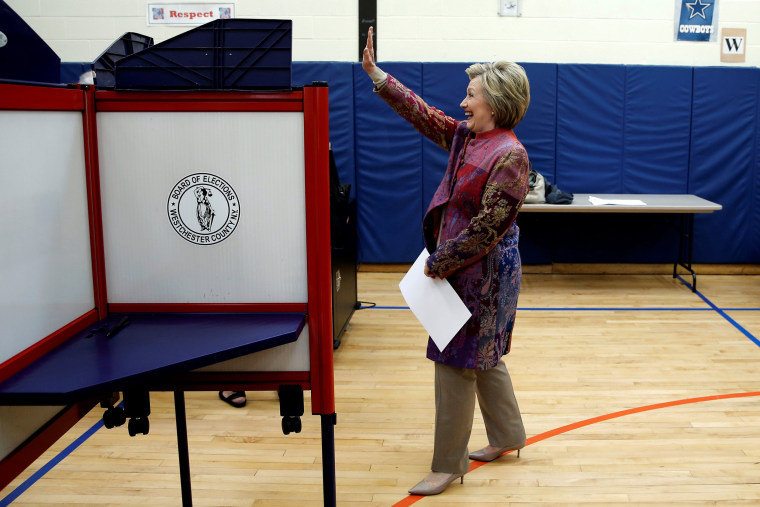 Image: Democratic U.S. presidential candidate Hillary Clinton waves as she carries her ballot to vote in the New York presidential primary election at the Grafflin School in Chappaqua
