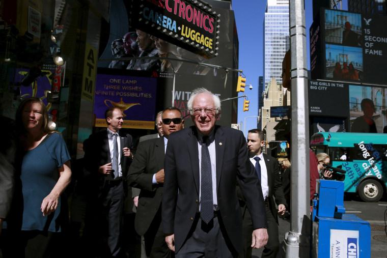 Image: Democratic U.S. presidential candidate Bernie Sanders walks around to greet pedestrians in the Times Square neighborhood of the Manhattan borough of New York