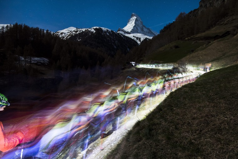 Image: Competitors climb in front of the Matterhorn as they start the 20th edition of the Glacier Patrol race