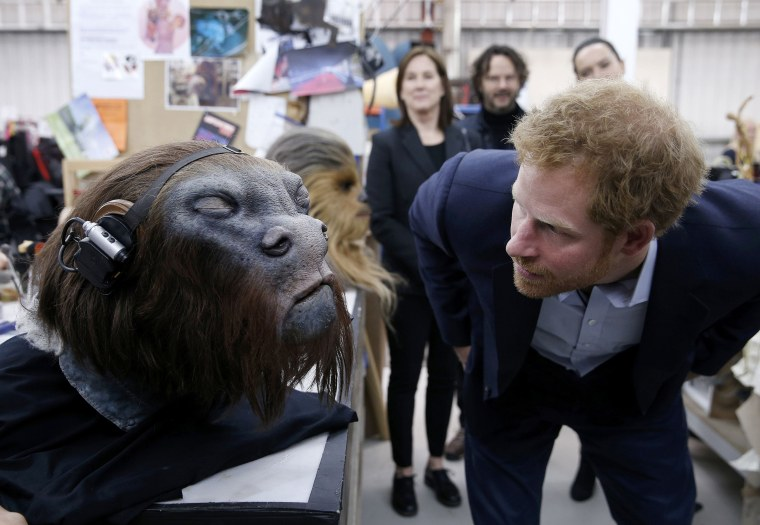 Image: Britain's Prince Harry takes a closer look at a robotic mask during a tour of the Star Wars sets at Pinewood studios in Iver Heath, west of London