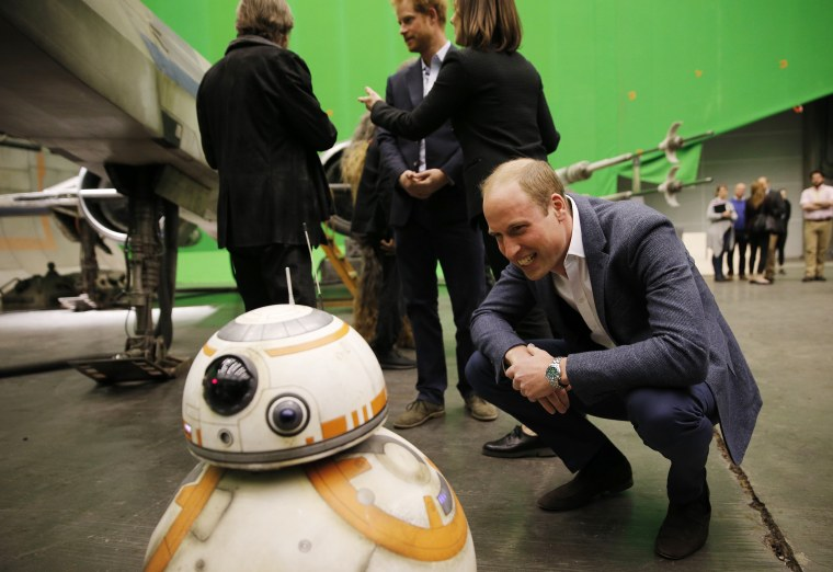 Image: Britain's Prince William looks at BB-8 droid