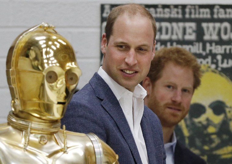 Image: Prince William and Prince Harry look at Star Wars character the droid C3P0