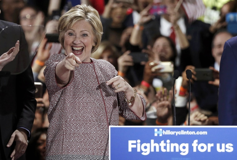 Image: Democratic presidential candidate Hillary Clinton arrives onstage at her New York presidential primary night rally in New York