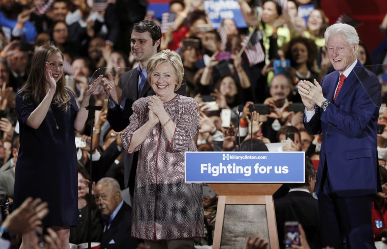 Image: Democratic U.S. presidential candidate Hillary Clinton reacts to the cheers of the crowd as she arrives onstage at her New York presidential primary night rally in New York