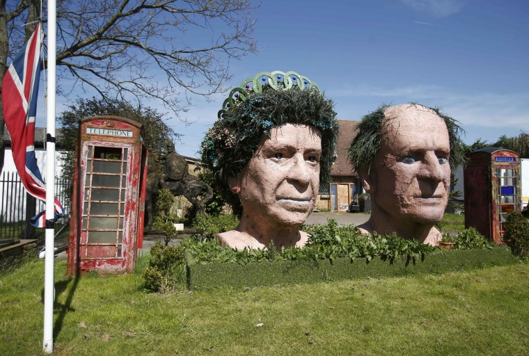Image: Two giant terracotta busts of Britain's Queen Elizabeth and Prince Philip on display in the garden of Fifield House Farm near Windsor