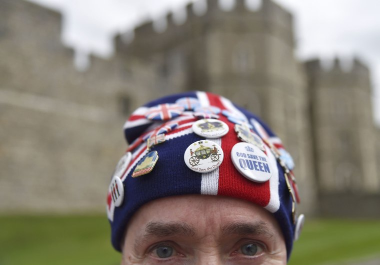 Image: Royal fan, John Loughrey, poses as he awaits the forthcoming birthday of Britain's Queen Elizabeth, in Windsor Britain