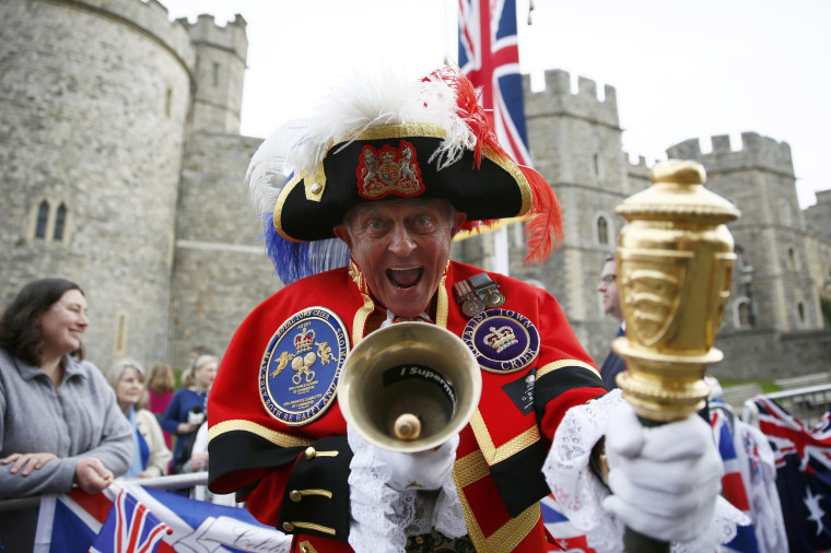 Image: A Royal fan dressed as a Town Crier gathers to celebrate Queen Elizabeth's 90th birthday in Windsor,