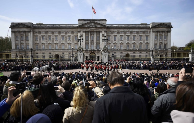 Image: Crowds gather to watch Changing of the Guard outside Buckingham Palace in London