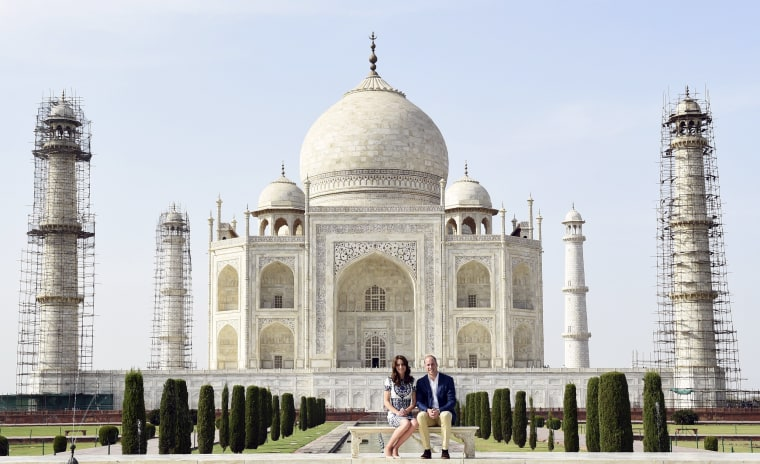 Image: Britain's Prince William and his wife Catherine, the Duchess of Cambridge, pose as they sit in front of the Taj Mahal in Agra