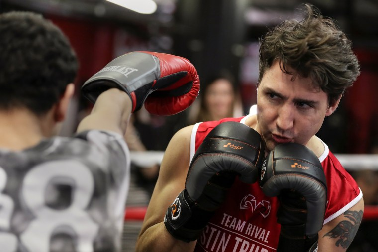 Image: Canadian Prime Minister Justin Trudeau dodges a punch as he spars in the ring at Gleason's Boxing Gym in the Brooklyn borough of New York