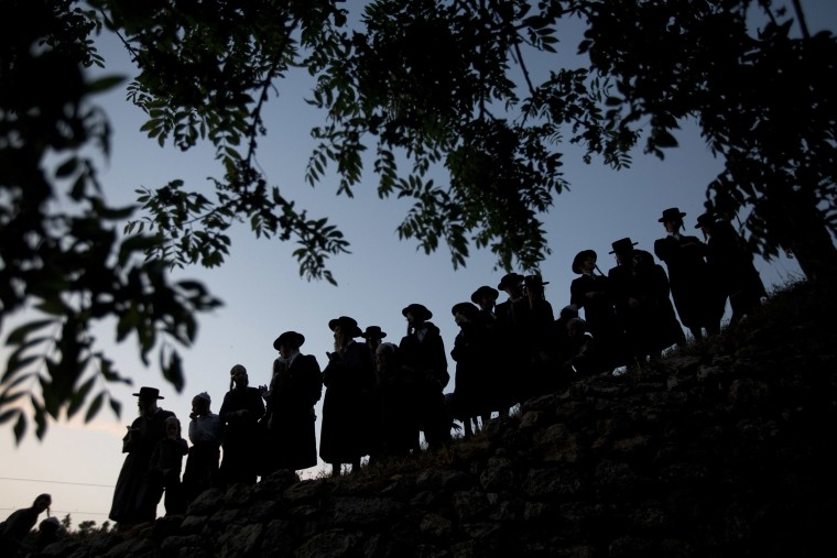 Image: Ultra-Orthodox Jewish men gather to collect water from a spring to make matza