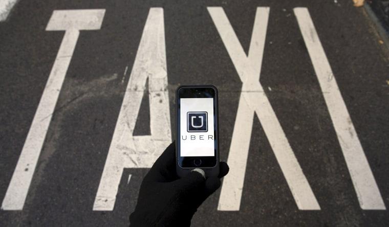 Image: The logo of car-sharing service app Uber