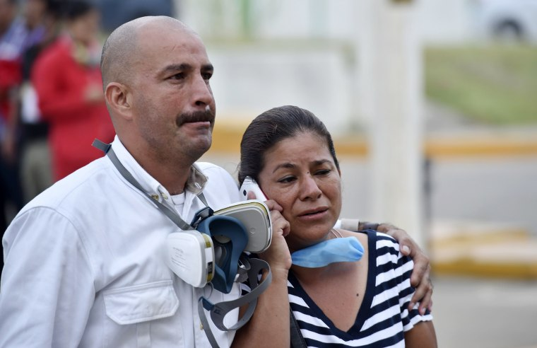 Image: Relatives wait for news of their loves ones at the Pemex plant