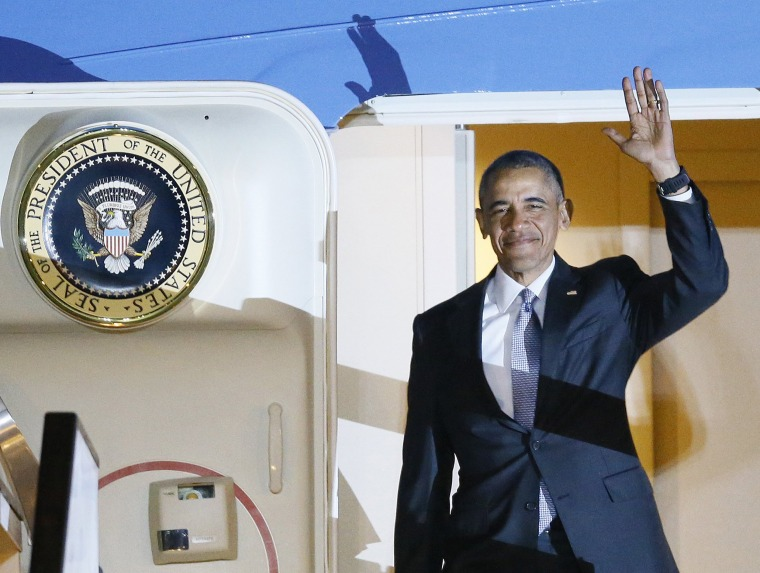 Image: U.S. President Barack Obama waves as he steps out of Air Force One on his arrival at Stanstead Airpor