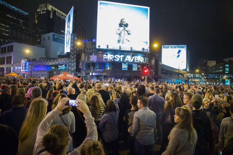 Image: People listen to Prince music during a memorial street party outside First Avenue nightclub
