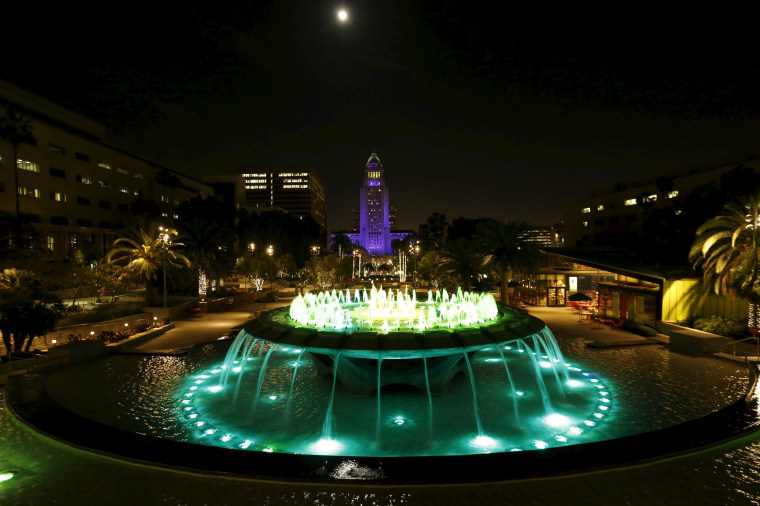 Image: City Hall is illuminated in purple in remembrance of the late singer in downtown Los Angeles, California.