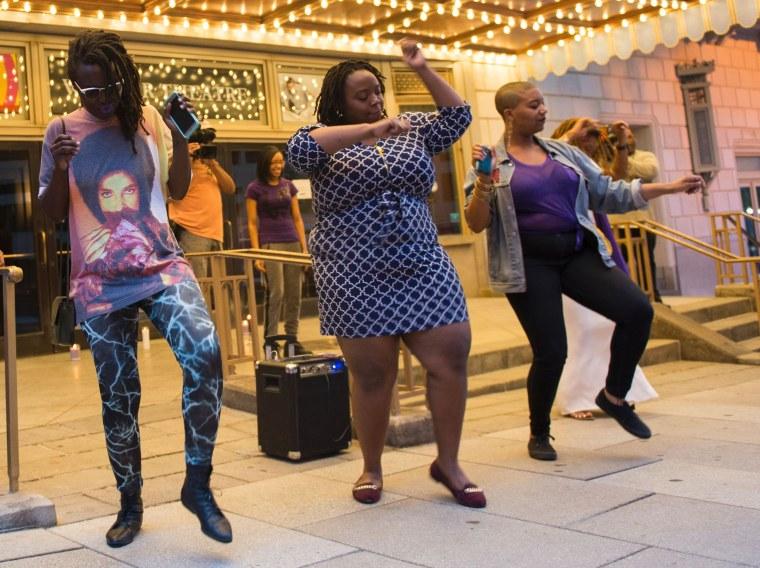 Image: People dance during a vigil  in Washington, D.C.