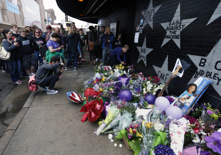 Image: Fans gather at a memorial at First Avenue Nightclub where the pop super star performed several times in his career