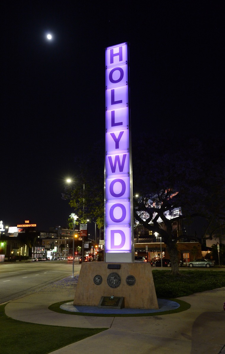 Image: A sign is illuminated in purple in memory of the late musician in Los Angeles, California