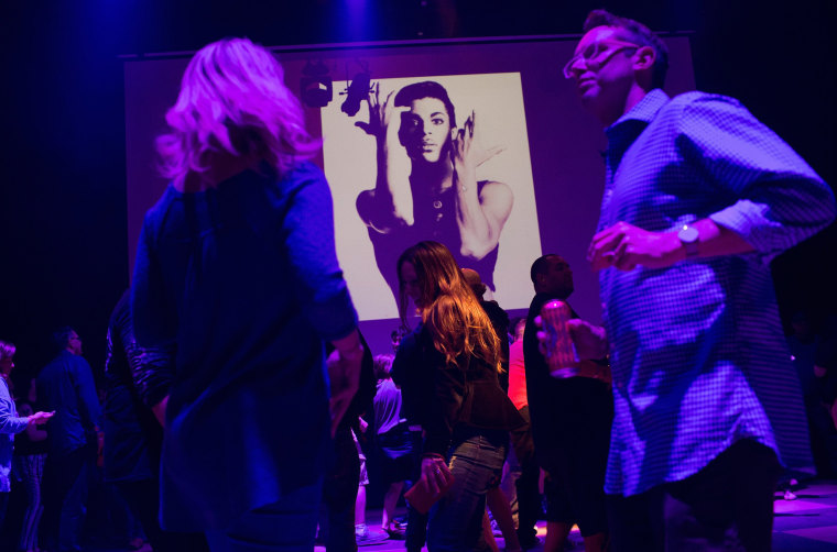 Image: Guests dance to Prince music as a slide show flashes images of the artist during a memorial dance party at the First Avenue nightclub