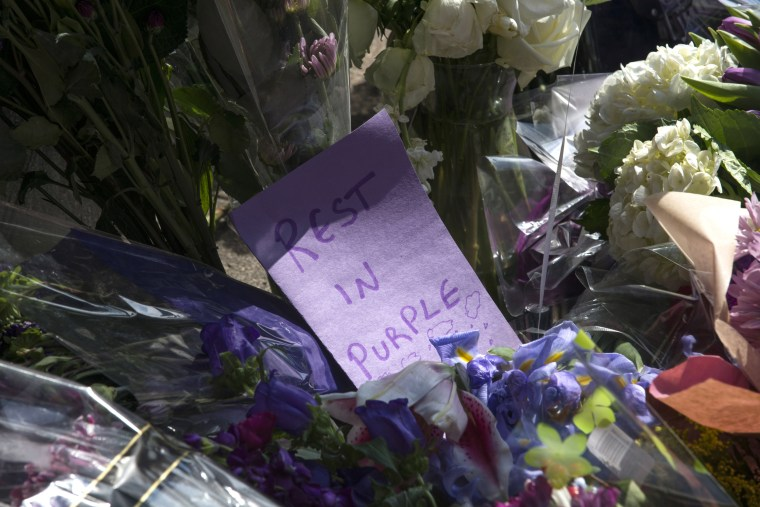Image: Flowers with notes lay at a memorial at First Avenue nightclub
