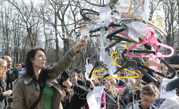 Image: Coat hangers at a protest in Warsaw, Poland, on April 3
