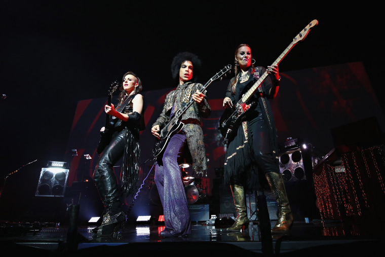 """Image:  Prince performs onstage with 3RDEYEGIRL during his """"HitnRun"""" tour"""