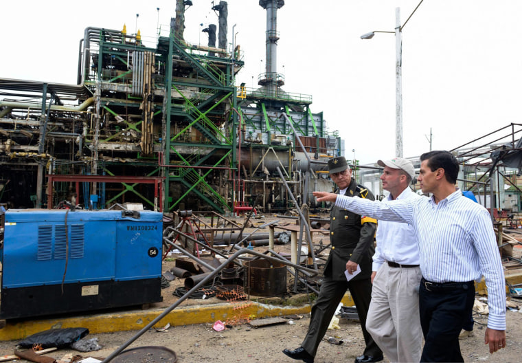 Image: Mexican President Enrique Pena Nieto, (R), during a visit to the site the explosion