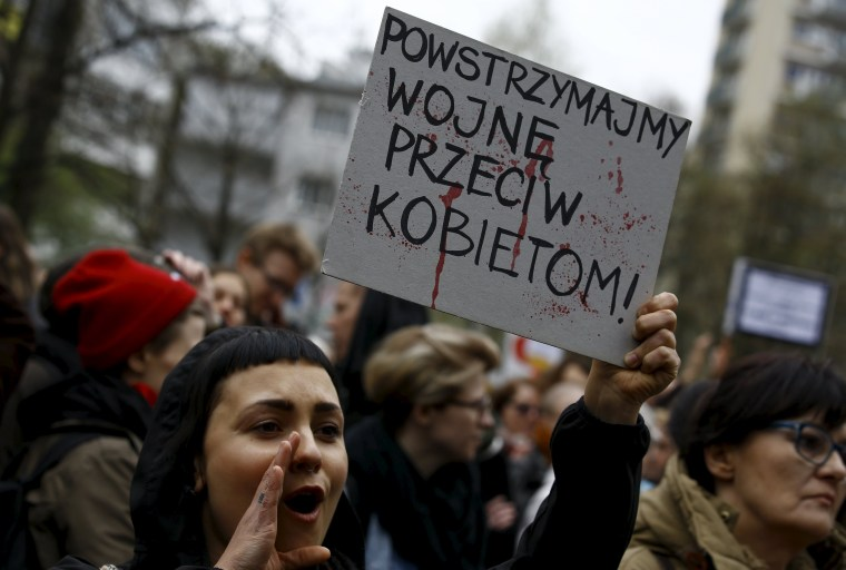 Image: Abortion rights advocate holds a placard at a rally in Warsaw on April 9